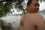 China, The many faces of Beijing. Li Kaye with his friends like to swim at lake. It is used from all ages.  © Maro Kouri