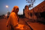 Egypt, Cairo:Life in Dead City  In the center of Segida Nafisa cemetery life never ends....  Seventeen year old Samar says: ''I live just above a couple of scientists'', and she runs to her trackman fiance  © Maro Kouri