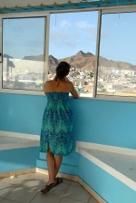 Capo Verde, Sao Vincente's capital Mindelo. Woman looks at Monte Verde from the Mindel hotel's roof garden  © Maro Kouri