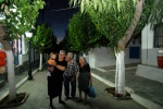 Greece, North Aegean,Fournoi, Kambos:The main road  is full of mulberries and leads to the square. Flitzani family (l) and 85year old Evdokia Ahladi (r) love their island and keep it alive for their grandchildren  © Maro Kouri