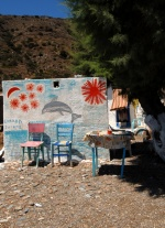 Greece, North Aegean,Fournoi, Hrisomilia. A naif graffity means ''GREECE I LOVE YOU'' is written on the wall of a summer little house, near the beach.  © Maro Kouri