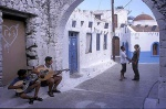 Greece, Nisyros. People in love dance in the street while two children play lute and buzuki. What else, more beatiful than this, could happen to a couple in a volcano island?  © Maro Kouri