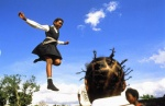 South Africa, Soweto,Johannesburg ex-ghetto during apertheid period. Trampoline jump.