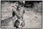 "Israel, Kibbutz ""Sarid"". Little girl embraces the gorund. © Maro Kouri © Maro Kouri"