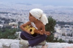 "Greece, Athens, Egaleo hill. Son of gypsie singer Kostas Pavlides plays ""kitharoni"".