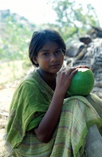 India,Puttaparthi village near Sai Baba's Ashram. Twelve year old Leem sits in a coconut plantation.  © Maro Kouri
