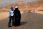 Egypt, Luxor,West bank: Two differently dressed friends outside the temple of Hatshepsut. © Maro Kouri