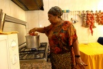 Cezaria Evora in her kitchen, cooks the delicious local dish 'cachupa' for everyone who passes by her place - like in the monasteries!Mindelo, Cape Verde © Maro Kouri