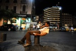 Athens: A man on his chemical nirvana. Midnight at the central Omonoia square: the great drug bazaar.  © Maro Kouri