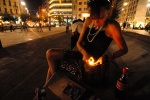 Athens: 22-year old Popi scores her 'junk' every evening in the central Omonoia square. Lack of heroin might stop her two months pregnancy, so, her doctor insists just to reduce it. Opium substance burns at her cigarette. © Maro Kouri