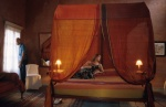 Dodecanese, Rhodes Marco Polo mansion, bedroom, canopy bed, woman lies down  © Maro Kouri