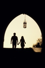 Dodecanese, Rhodes The entrance to the large castle, sunset, couple holding hands