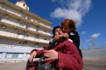 A moment of happiness for mother Margarita Ionannidou and her 19 y.old daughter, in the courtyard of ''KE.PE.P''. She travels for 500km to see her. Only the 20% of the family chaperons visits the center once a month.  Center for Nursing Children (''KE.PE.P'') in the small city of Lehena. Ileia prefecture, Southwest Greece.    © Maro Kouri