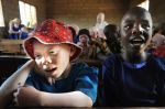 Both albino and coloured students inside a classroom of Mitindo Primary School of Misungwi district.  Mwanza, Tanzania, Africa    © Maro Kouri