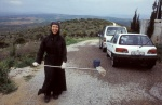 Joyful South African nun washes... the pilgrims' cars! Monastery of holy Cross, Vaya, Thebes, Central Greece  © Maro Kouri