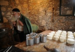 Priest-monk Grigorios Kladis, is the only residence of the the 16th cent.  monastery. He makes cheese, bread, he cultivate vegetables and he helps tor the renovation of the cloister that started the last years.  Island Strofades is 37 sea miles far from Zakynthos. Eptanese, Greece  © Maro Kouri