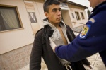 Frontex guards arrest 22-year-old Mohammed on a cold January morning in Nea Vyssa, northern Evros, where temperatures plunge during the winter. The village is a 10-minute drive from the 12.5km land border between Greece and Turkey, where 26,000 migrants passed through last year. Mohammed was found wandering the streets. He says he is from Palestine. Most migrants say they are from countries like Palestine, Afghanistan and Somalia so they won't be deported  © Maro Kouri