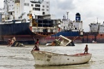 Bangladesh shipbreakers have illegally beached 16 toxic ships for scrapping on the Chittagong coast last month according to the NGO Shipbreaking Platform, a global coalition of environmental, human and labour rights non-governmental organisations working for safe and clean ship recycling. «It is a clear violation of the 2009 High Court order that stated that no ship could be beached without an environmental clearance certificate that guarantees that they are free of all in-built toxic materials» explains Rizwana Hasan, Goldman Prize winner and Exectutive Director of Platform member, Bangladesh Environmental Lawyers Asssoication (BELA).  Shifts start at seven in the morning and go through till eleven at night with two hours in breaks. The work is done on or around the beach by unskilled laborers who travel from the poorest parts to work for a pittance, largely without any representation. No latrines or showers exist, and disease is rife. The sites see asbestos thrown freely about, the dust filling the air, the toxic smoke from metal cutting drifts amongst the workers. Heavy metals run freely into the sand along with the waste lubricants to wash out to sea.  The Geneva based International Metalworkers Federation, who published an extensive survey in 2007 on working practices in the region, estimates that in Bangladesh a worker dies in the breaking yards every three weeks on average. Although there are safer and cleaner methods for recycling ships, cashbuyers  continue to sell their vessels to the poorest countries of South Asia to gain maximum profit///Fishermen's children in their boats among the huge broken ship parts   © Maro Kouri