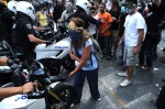 Demonstrations and riots during the second day of the general strike against the second Memorandum///Woman who wears surgery mask and swimming glass to protect herslef frpm the tear gas, tries to prevent the police motocyclists to attack.  © Maro Kouri