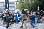 Riots during a rally against plans for new austerity measures///Protestors clash with riot police during a demonstration near the parliament in the center of Athens.   © Maro Kouri
