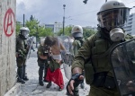 Riots during a rally against plans for new austerity measures///Protestor  arrested and taking off his clothes by riot police during a demonstration near the parliament in the center of Athens.   © Maro Kouri