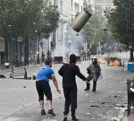 Riots during a rally against plans for new austerity measures///Protesters clash with riot police   © Maro Kouri