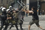 Riots during a rally against plans for new austerity measures///Protesters clash with riot police in front of the Greek parliament  © Maro Kouri