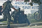 Protesters clashed with riot police over the Greek government's austerity measures///Riot policemen arrest a protester in the parliament sq   © Maro Kouri