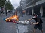 Riots during a rally against plans for new austerity measures///Protestor with stones and fire against the riot police who trought tear gas at Parliament square  © Maro Kouri